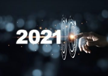 Hand touching pass thru infographic to 2021 year with blue bokeh and dark background. New year change concept.