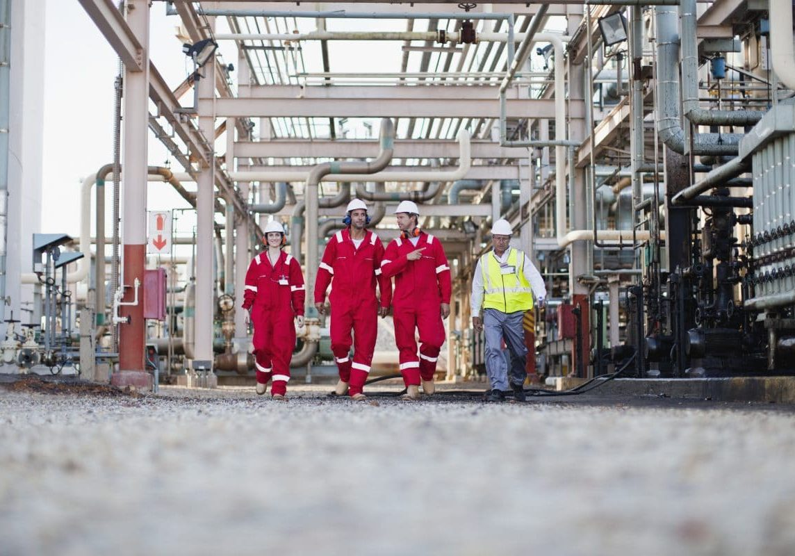 Workers walking at chemical plant